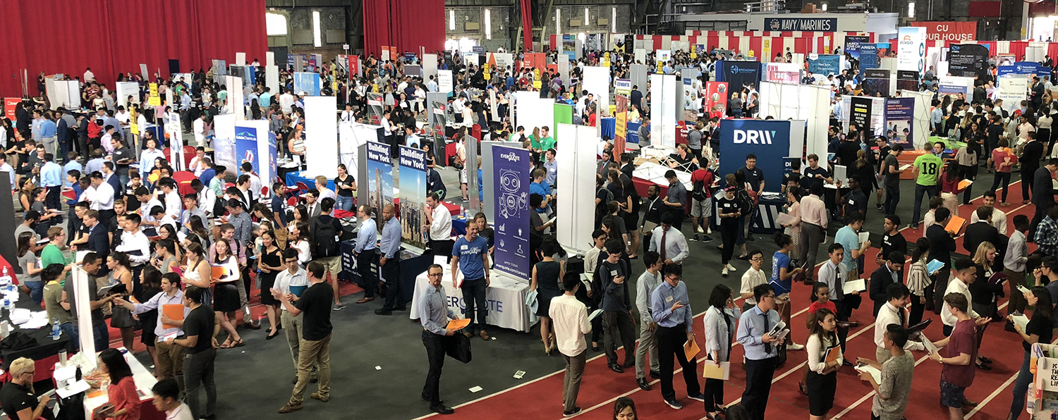 Students and employers inside of Barton Hall talking and meeting at the annual career fair