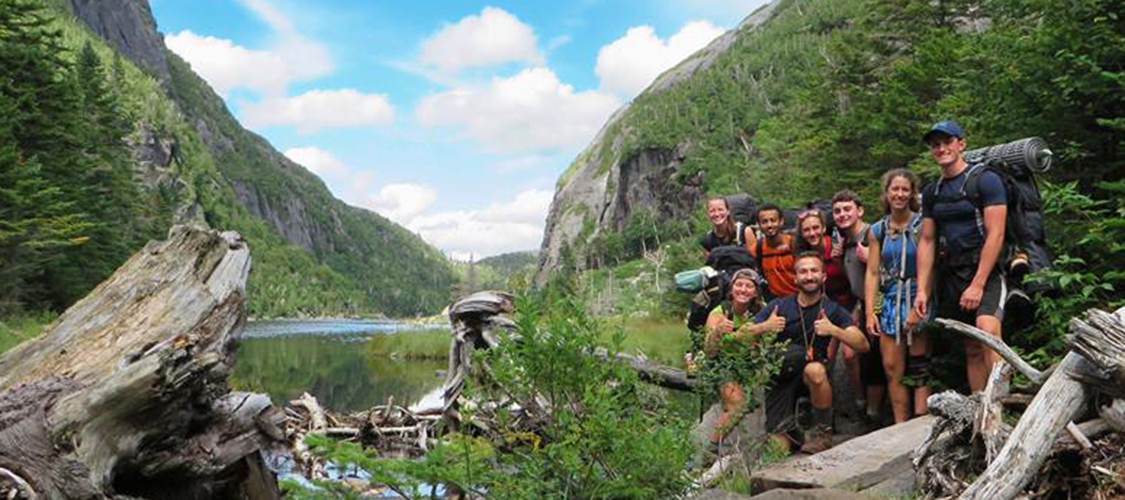 A group of backpackers at Avalanche Lake in the Adirondacks