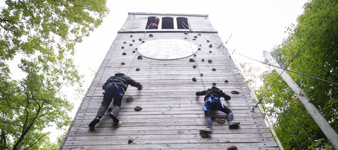 Climbers on a high element of the challenge course
