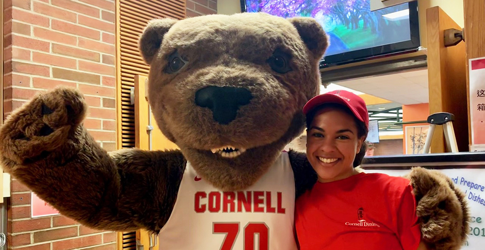 Touchdown the Bear with student Cornell Dining staff member