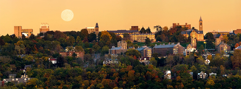 Panoramic view of Cornell with moon on the skyline