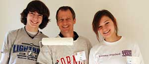 Three Cornell Cares Day volunteers smiling