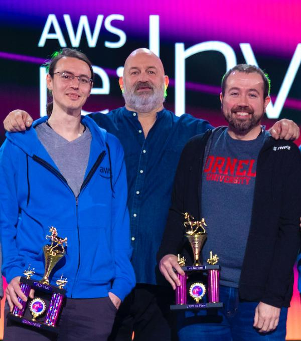 Tad Merchant, Dr. Werner Vogels (Chief Technology Officer, AWS) and Eric Grysko receiving the AWS GameDay award