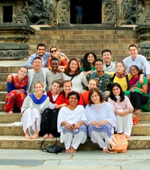 Merrill Scholar Malikul Muhamad, third row, fifth from left, traveled to India in summer 2018 along with Donna Ramil, associate director of the ILR School's Office of International Programs, seated in front on right, as part of the India SVYM Global Service Learning Program. The group visited Belur Temple to learn about the history and architecture of the temple and its engravings.