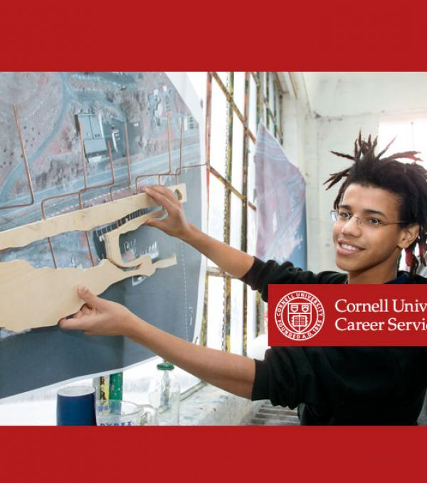 Student Working with Career Services logo imposed