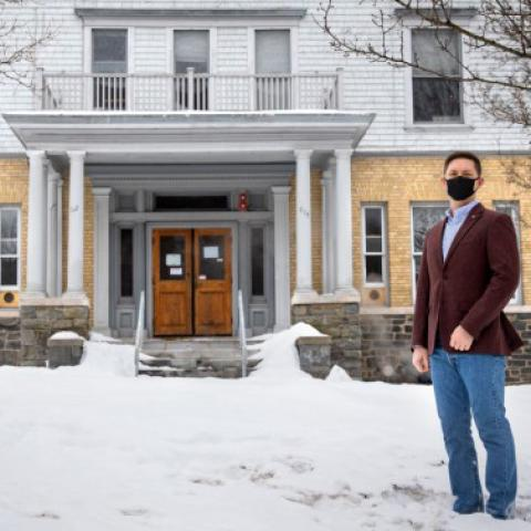 Mark Minton '23, CUVA's current vice president, stands in front of 625 University Ave., a university-managed property that will become a program house for undergraduate student veterans this fall